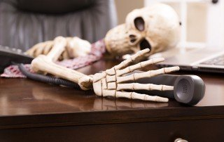skeleton on phone